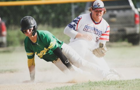 Dylan Lehr steals second base before coming around to score in the first inning of Menno's Thursday night game against Lesterville. The Mad Frogs held a 1-0 lead until the Broncs scored three runs in the third inning en route to a 7-5 victory.