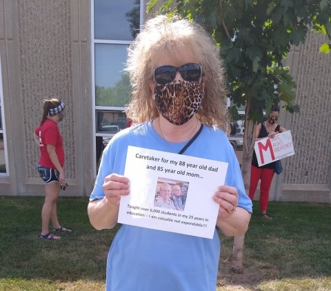 Sioux Falls art teacher Susan Waagmeester protested outside the school board meeting on July 13, pushing for more protections in schools against the spread of the coronavirus. Photo: Courtesy Sioux Falls Argus Leader