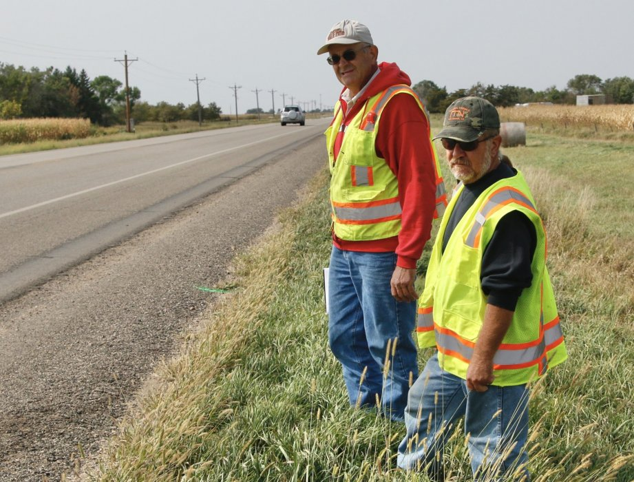 Nick Nemec, left, and his brother, Victor, have made several visits to the scene of the accident on U.S. Highway 14 west of Highmore, S.D., where their cousin Joseph Boever was killed after being struck by a car driven by South Dakota Attorney General Jason Ravnsborg on Sept. 12, 2020. Photo: Nick Lowrey, South Dakota News Watch