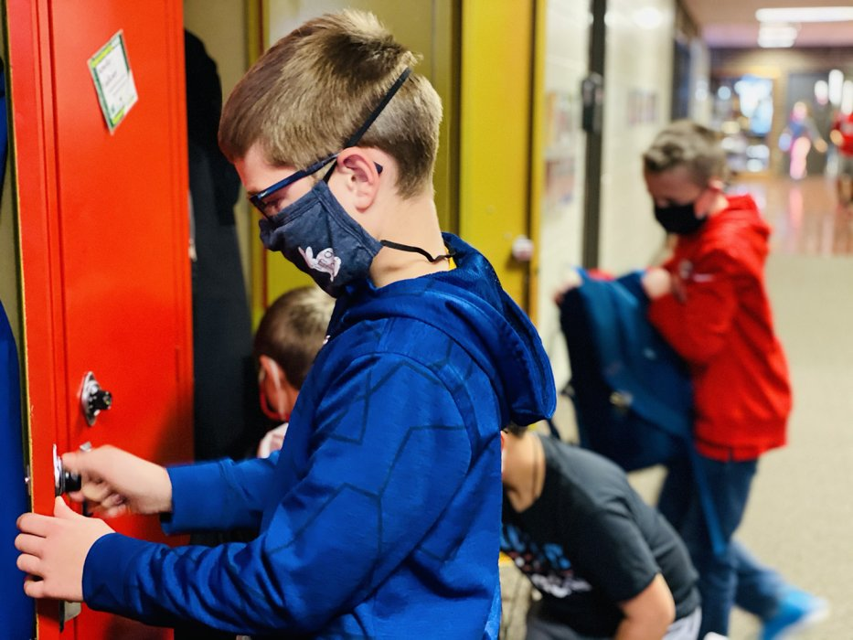 Freeman Public sixth-grader Riley Gall opens his locker at the end of the school day Tuesday, Oct. 27. The district has moved to tier 2 of its in-person educational plan given the surge of cases locally; that means the requirement of face coverings when distancing cannot be achieved.