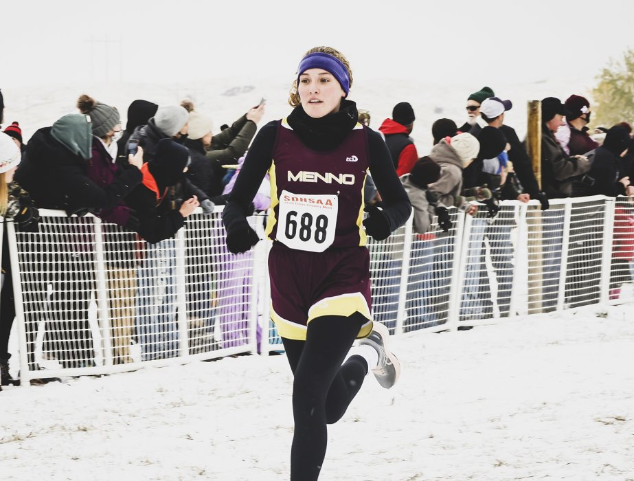 Menno's Morgan Edelman finishes hard in the final cross-country race of her prep career in Rapid City on Saturday. The senior has competed at state every year since she was a seventh-grader and medaled twice. She was 55th on Saturday — the same spot she finished as a freshman.  	PHOTO BY JEREMY WALTNER