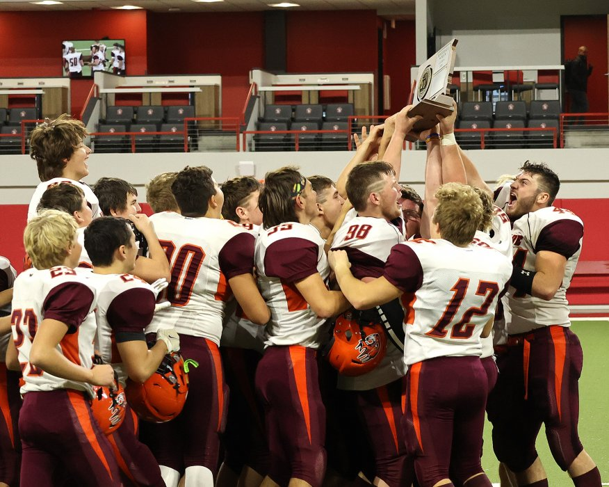 Freeman senior Clayton Smith (right) and the Pride celebrate another Class 9A title. PHOTO BY JEREMY WALTNER