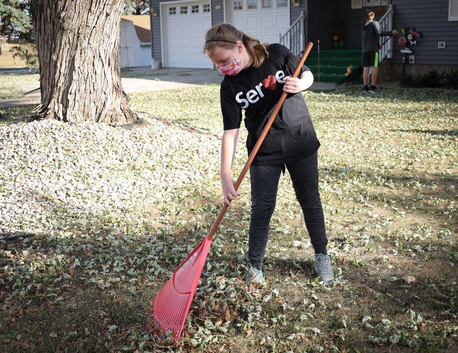 Freeman Academy students like Madelyn Anderson spent Friday, Nov. 6 raking leaves at homes in Freeman.