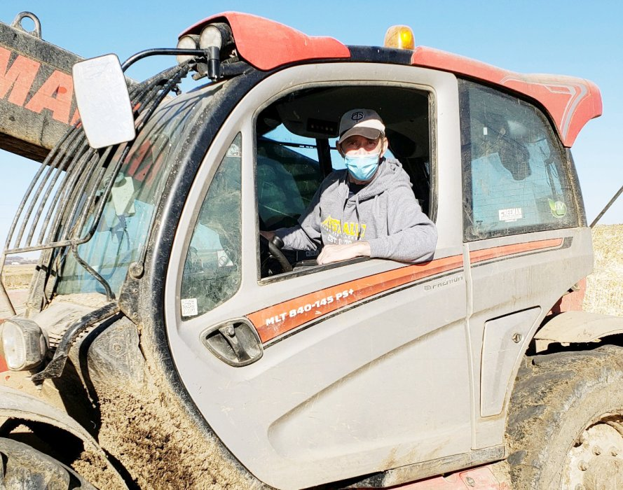 "Don Waltner is pictured in his telehandler in the weeks after returning home on Oct. 30. Easy work like stacking bales was something that Don was able to do around the farm following his recovery from a brain bleed and three subsequent surgeries in Sioux Falls, and something he says ""helped give him purpose."" COURTESY OF SONJA WALTNER"