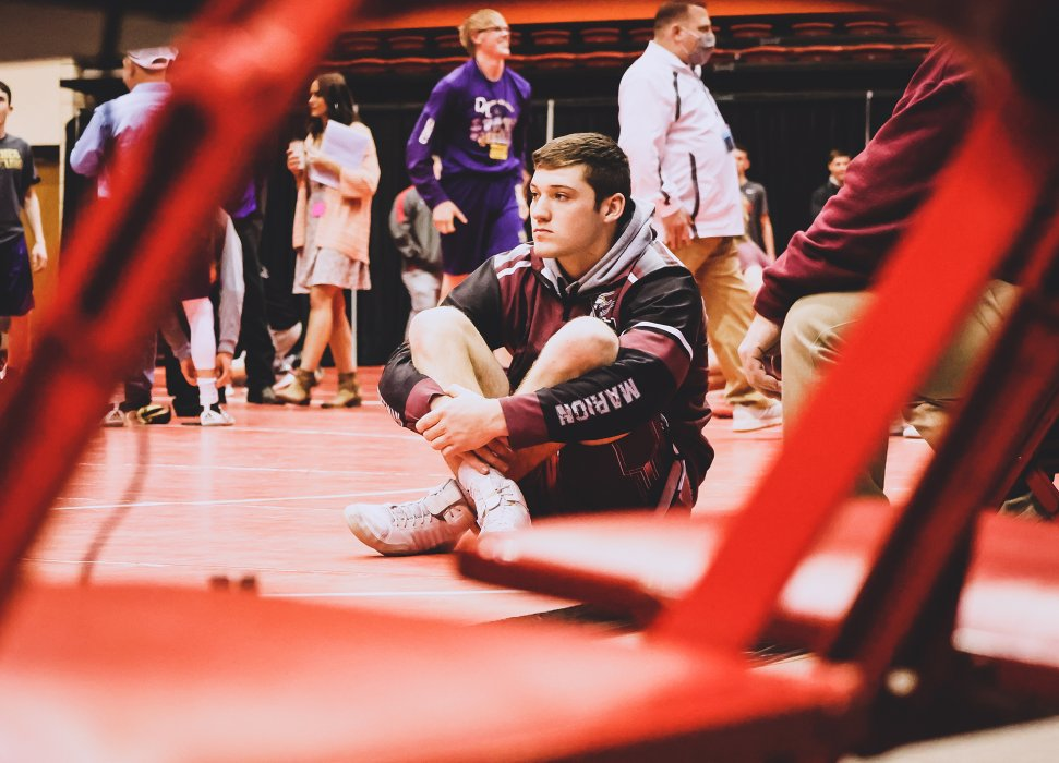 Clayton Smith waits on the mat prior to the start of Saturday's consolation round. Wrestling will continue throughout the day, with championships tonight.